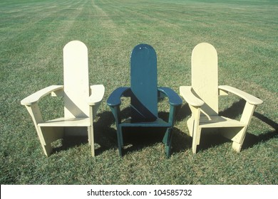 Three lawn chairs on lawn, Middlebury College, VT