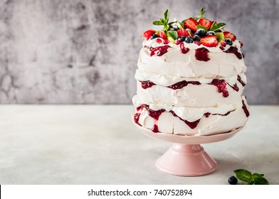 Three Layer Pavlova Cake with Whipped Cream, Raspberry Jam and Assorted Fruit and Berries, copy space for your text