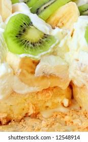 three layers of pavlova cake: fruits, cream, meringue and souffle