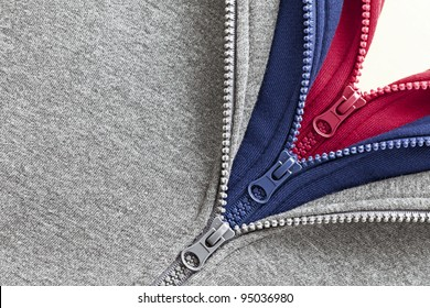 Three layers of sweaters in different colors