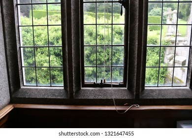 Three leaded glass panes from a stately home window. Three leaded panes of glass from a window of a stately home in England.