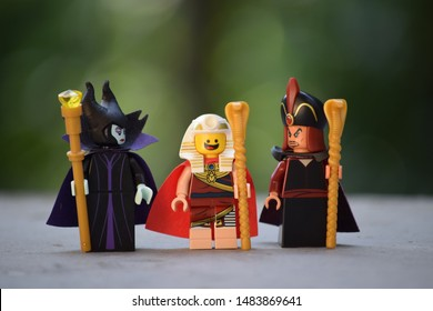 Three Lego mini figures from different sets. Lego Benny, Jafar and an evil witch. Lego is a brand/company from Denmark.