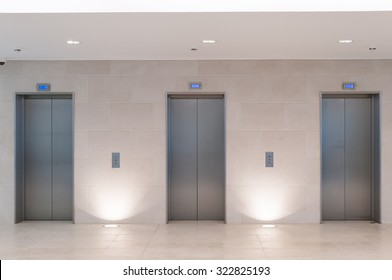 Three lift doors in office building
