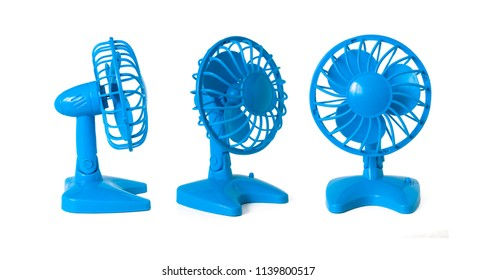 Three light blue fans with propeller and protective grill, on batteries, isolated on white background