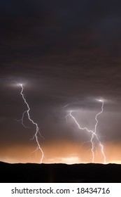 Three Lightning Strikes at Dusk