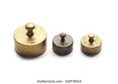 Three little antique weights at white background