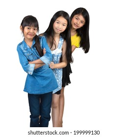 Three little asian girl standing, Isolated over white