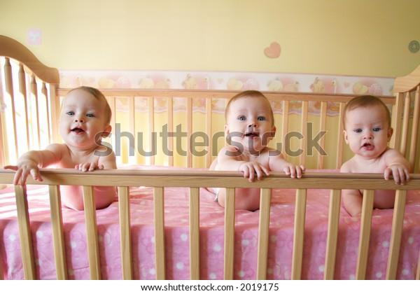 Three Little Baby Girls in Crib