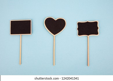 Three little Chalkboards isolated on light blue background