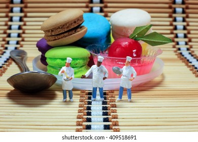 Three little cooks with dessert background.