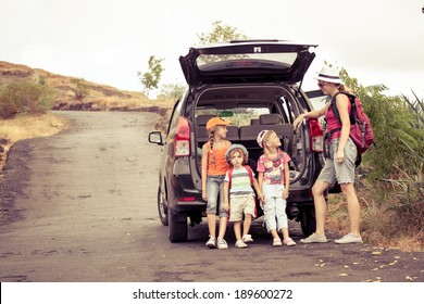 three little kids and mother in the mountains