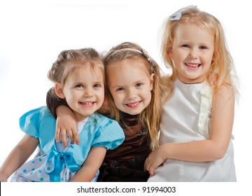 three little pretty smiling girls
