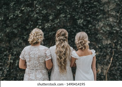 three long girls with professional hair updos, ivy green background