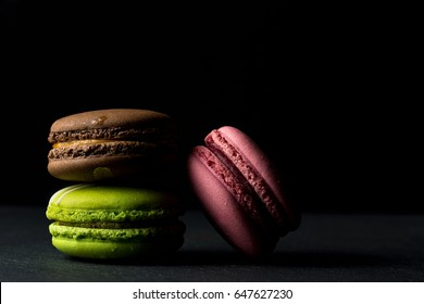 Three macaroons on black