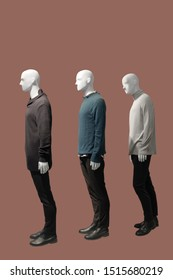 Three male mannequins dressed in casual clothes, isolated. No brand names or copyright objects.
