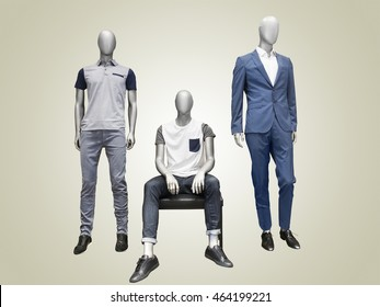 Three male mannequins dressed in casual clothes over yellow background. No brand names or copyright objects.