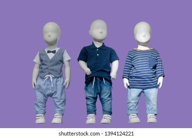 Three mannequins dressed in fashionable kids wear, isolated. No brand names or copyright objects.