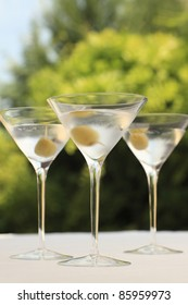 Three martini cocktail with olive
