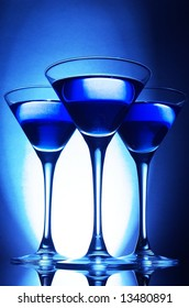 Three martini glasses in blue