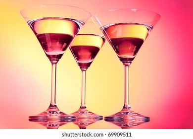 Three martini glasses on red background