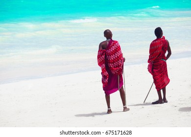 Three masai tribe member standing near the ocean in Zanzibar 4 February 2017