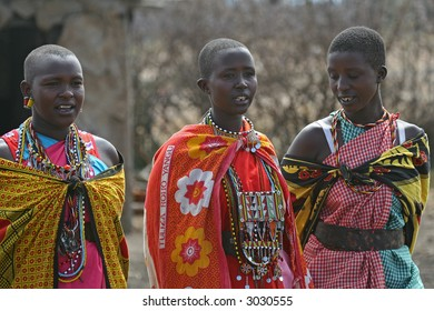 Three Masai Women in traditional African outfit