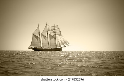 Three mast schooner under sails on the baltic sea. Sepia Toned.