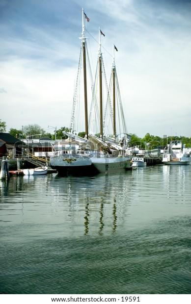 Three masted schooner in New England harbor