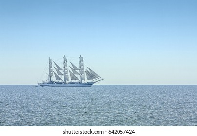 Three masted windjammer in full sails on the Black Sea on the horizon.