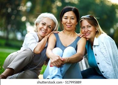 Three mature ladies enjoying on a nice day outside