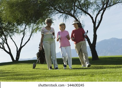 Three mature women walking on golf course