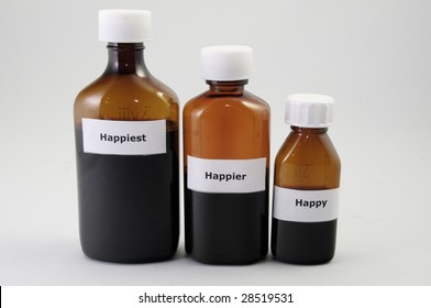 Three medicine bottles partially filled on  with white background.They have writing on them.