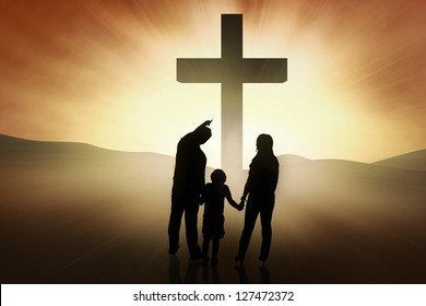 Three members of family are standing at the bright Cross