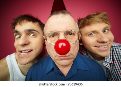 Three men of different age looking at camera, fool�s day celebration