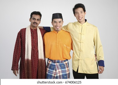 Three men at different races, posing in front of camera