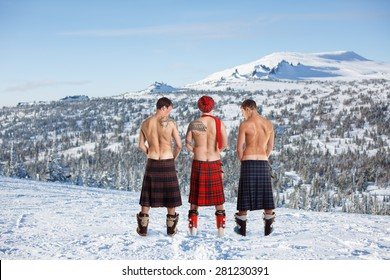 Three men peeing on the top of the mountain