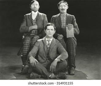Three men posing in their Sunday best