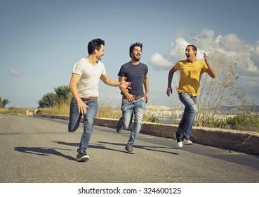 Three men running in the street