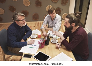 Three men working at the office