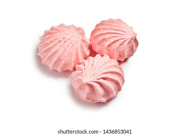 Three Meringue airy cookies. Meringues kisses in pink color isolated on white background