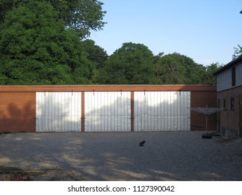Three Metal sliding doors in farmyard in Southern Denmark