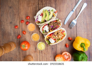 three mexican pork carnitas tacos, Vegan tacos, Chicken tacos flat lay composition