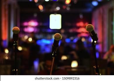 Three Microphones At Bar Nighttime