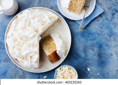 Three milk cake, tres leches cake with coconut. Traditional dessert of Latin America Top view Copy space