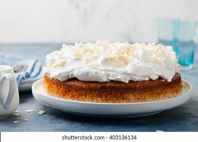 Three milk cake, tres leches cake with coconut. Traditional dessert of Latin America Copy space