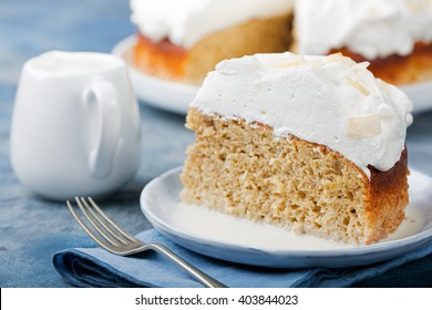 Three milk cake, tres leches cake with coconut. Traditional dessert of Latin America