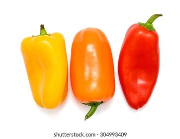 three mini peppers isolated on white