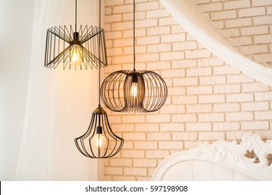 three modern black lamps hanging