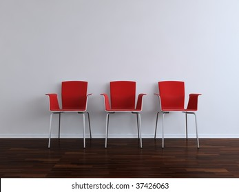 Three modern red Chairs to face a blank white wall
