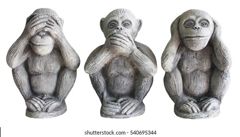 Three monkey isolated on white background,close up of hand small statues with the concept of see no evil, hear no evil and speak no evil.